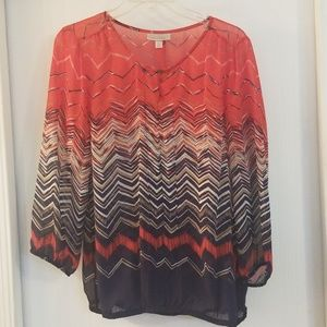 Sheer navy, tan, orange-red blouse